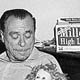 Photo of Charles Bukowski cradling a newborn daughter, the result of a one night stand with a mannequin, 1970s