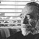 Photo of Charles Bukowski at his Carlton Way court apartment, 1970s