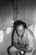 Photo of Charles Bukowski on the toilet
