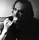 Photo of Charles Bukowski licking his finger