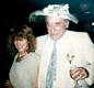 Photo of Charles Bukowski wearing a ladies hat at his wedding