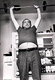 Photo of Charles Bukowski lifting weights
