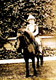 Photo of young Charles Bukowski riding a pony